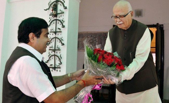 BJP President Nitin Gadkari greets senior BJP leader LK Advani on his birthday in New Delhi