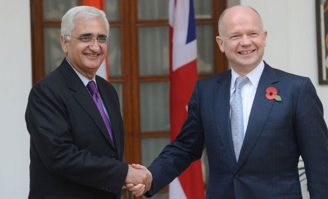 Indian Minister for External Affairs Salman Khurshid (L) welcomes British Secretary of State