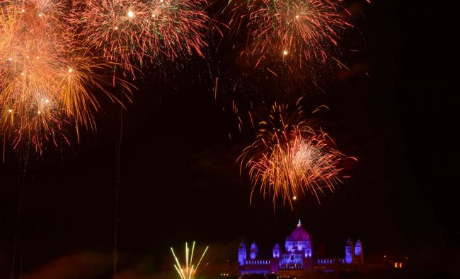 ) In this photograph taken on November 8, 2012, fireworks light the night sky at the Umaid Bhawan...