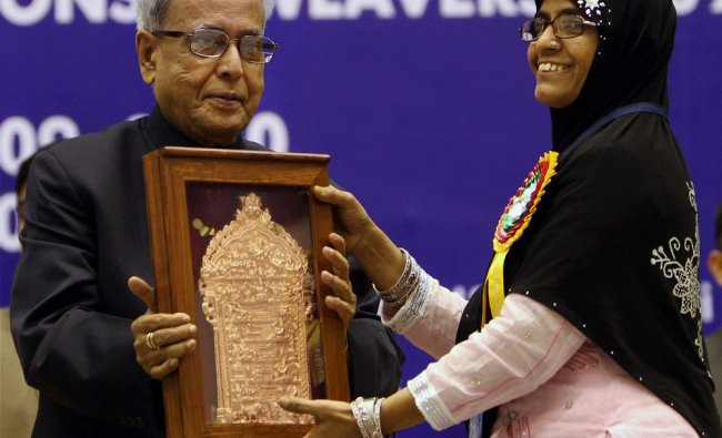 President Pranab Mukherjee presenting the Natinal Award to a recipient during a function...