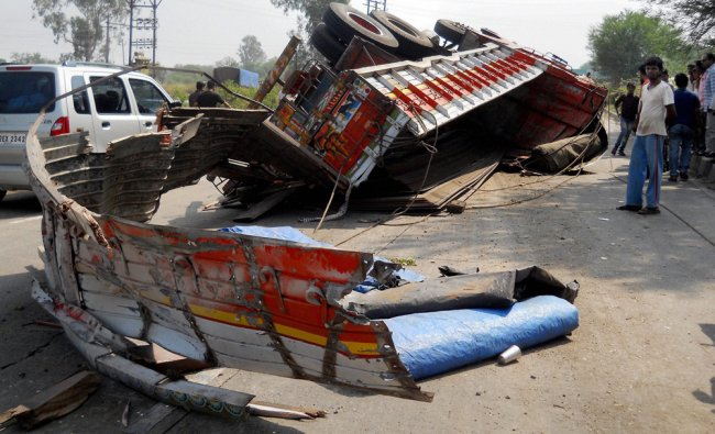 Mangled remains of a truck after an accident at Pune-Bengaluru National Highway...
