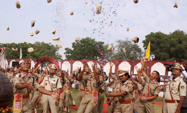 Cadets jubilate after their passing out parade at CRPF academy, Kadarpur in Gurgaon on Saturday...