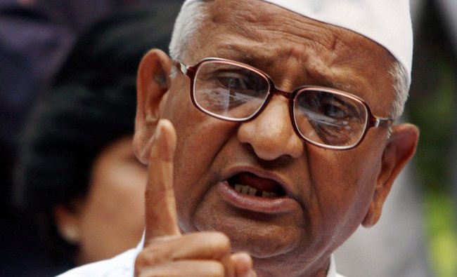Anna Hazare speaks during a press conference after a meeting of his core committee