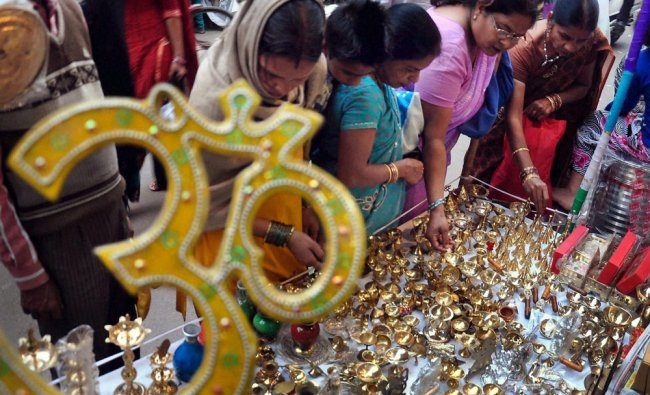 Women buy utensils on the occassion of Dhanteras at a market in Moradabad on Sunday...