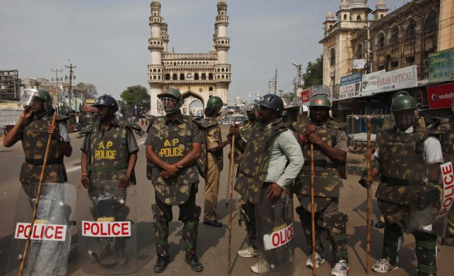 Policemen stand guard a street near Charminar during a protest in Hyderabad on Sunday...
