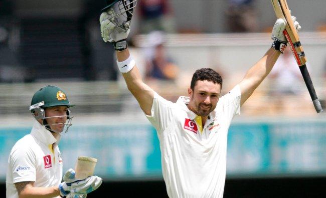 Australia\'s Ed Cowan (R) celebrates his century against South Africa as his teammate Michael Clarke