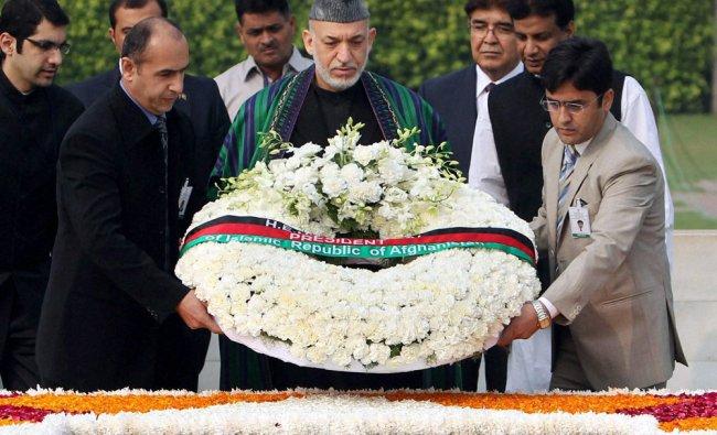 Afghan President Hamid Karzai paying homage to Mahatma Gandhi at Rajghat in New Delhi...