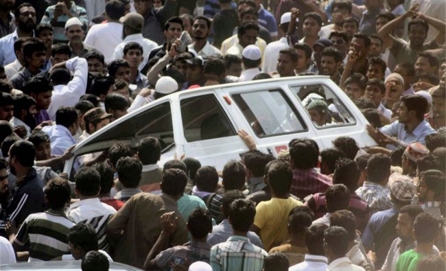 Angry mob vandalise a vehicle in Hyderabad on Monday, a day after violent protests in the city.