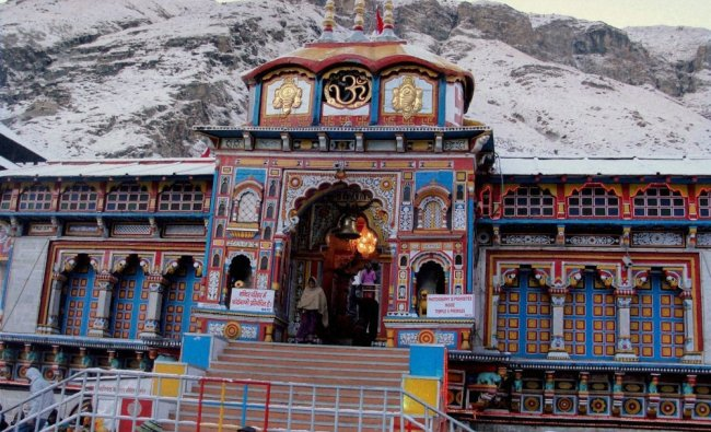A view of snow clad hills in the backdrop of Badrinath temple after fresh snowfall in Badrinath...