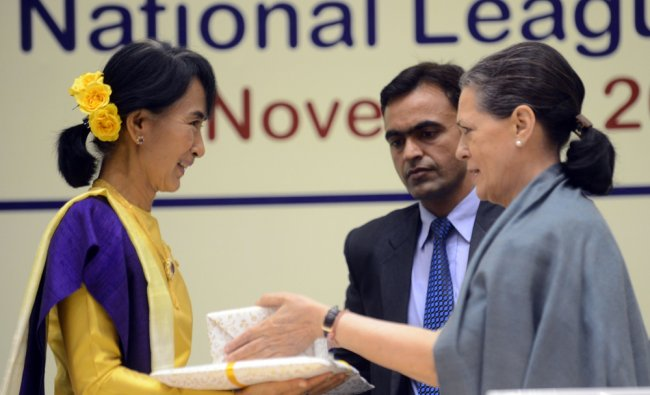 Aung San Suu Kyi receives a gift from Sonia Gandhi during Suu Kyi\'s Nehru Memorial Lecture...