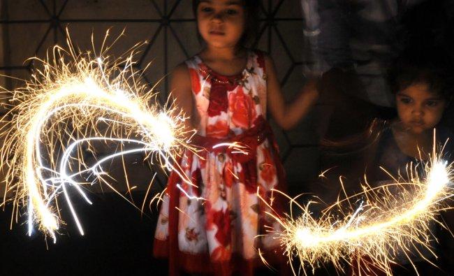 Children burst firecrackers at Shankar Mutt Road on Diwali night in Banglore on Wednesday...