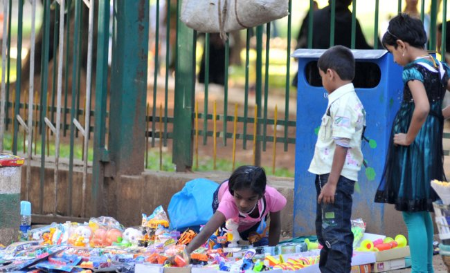 The Children\'s day comes and goes just like an other day for this kid who sells toys at Cubbon Park