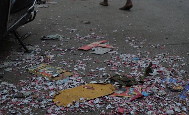 Wastage of bursting crackers on road during Diwali festivities adding more garbages in Bangalore...