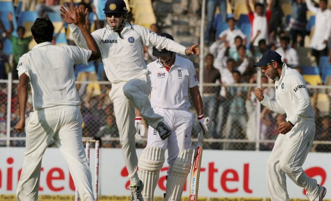 Ashwin celebrates with Gautam Gambhir after dismissing J Trott
