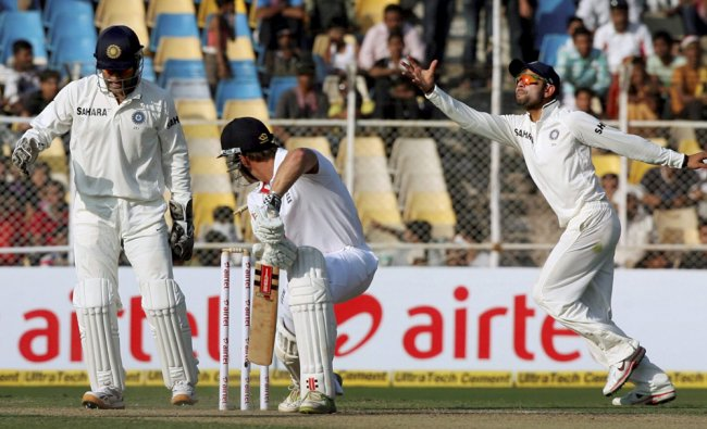 England opener N Compton is bowled out during the first test match...
