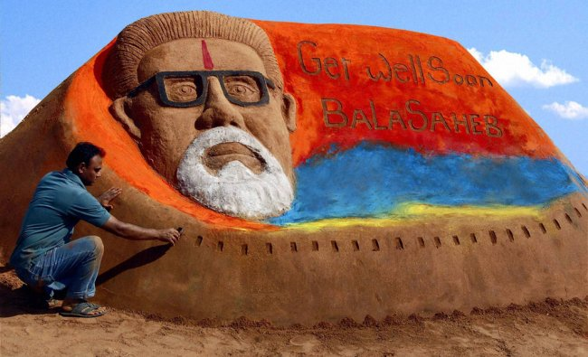 Sand artist Rajesh Muliya creates a sand sculpture of Bal Thackeray
