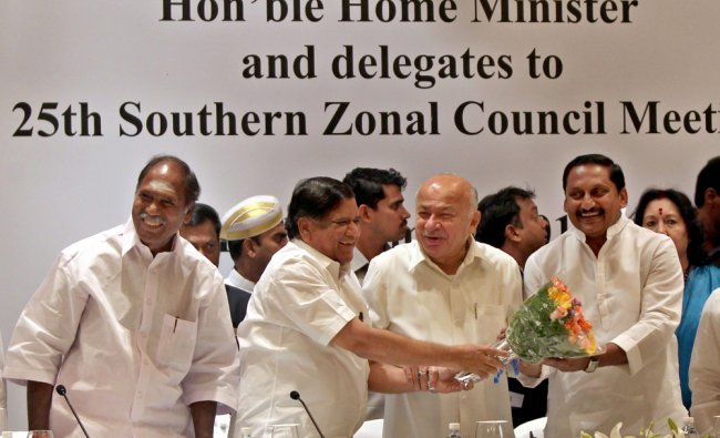 Union Home Minister Sushil Kumar Shinde being presented a bouquet by Jagadish Shettar