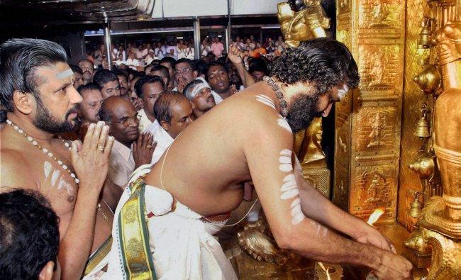 Head Priest opening the sanctum sanctorum of Ayyappa temple
