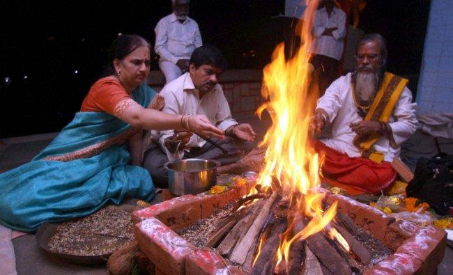 Relatives pray for the good heath of the ailing Shiv Sena Chief Balasaheb Thackeray in a temple...