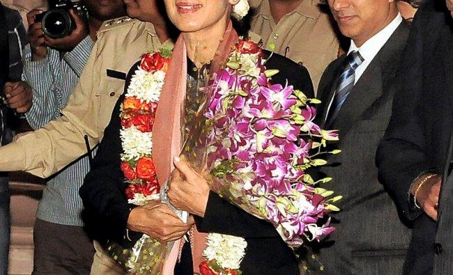 Myanmar\'s opposition leader Daw Aung San Suu Kyi on her arrival in Bengaluru...