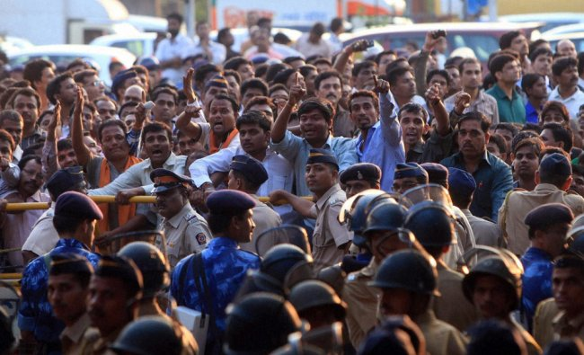 Grief-stricken supporters near the police barricades after Balasaheb Thackeray died...