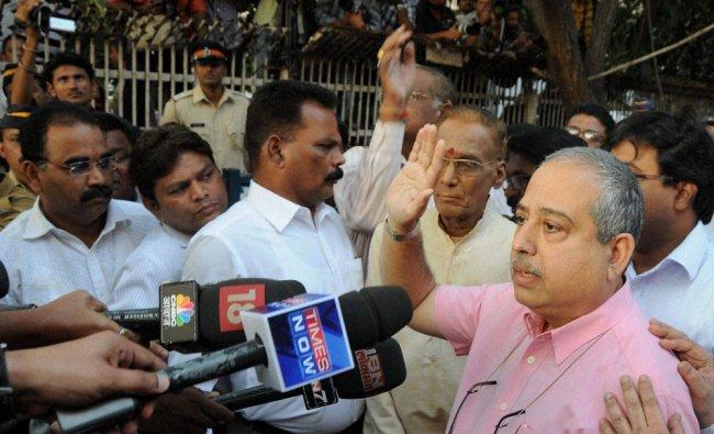 Doctor Jaleel Parkar gestures as he announces the demise of Shiv Sena chief Balasaheb Thackeray...