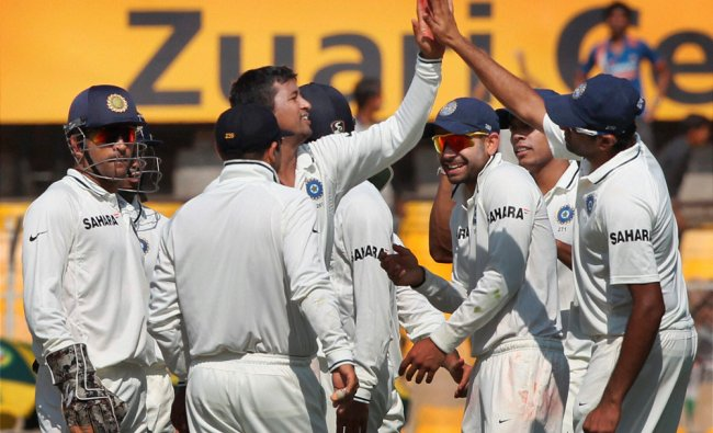India\'s P Ojha celebrates the dismissal of England\'s T Bresnan during Day 3 of the first test...