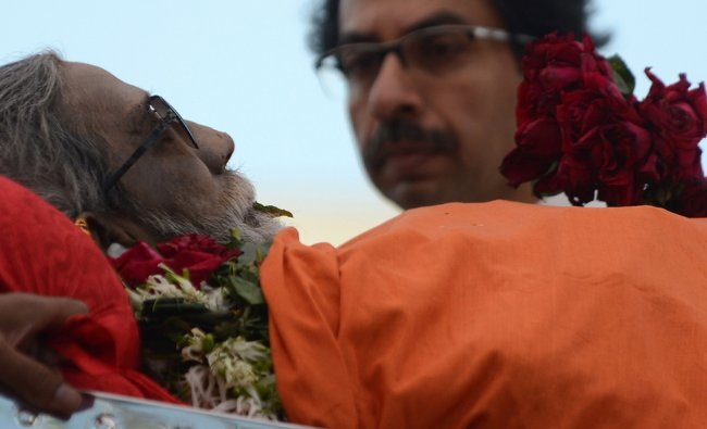 The body of Leader of Indian Hindu nationalist Shiv Sena party Bal Thackeray is watched...