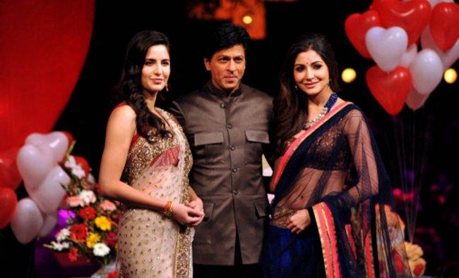 Indian Bollywood actresses Katrina Kaif (L) and Anushka Sharma (R)pose with actor Shah Rukh Khan....