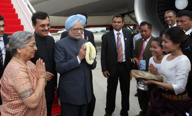 Prime Minister Manmohan Singh with his wife Gursharan Kaur being welcomed...