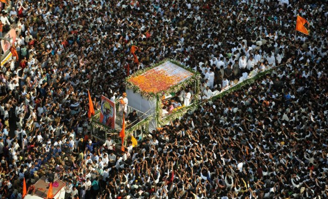 Supporters take part in the funeral procession of Shiv Sena party leader Bal Thackeray in Mumbai...