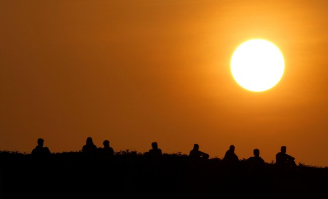 Spectators watch from the Galle Dutch fort during the second day of the first test cricket match...