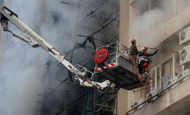 An Indian firefighter and a police officer investigate a fire that broke out in a fifteen story...