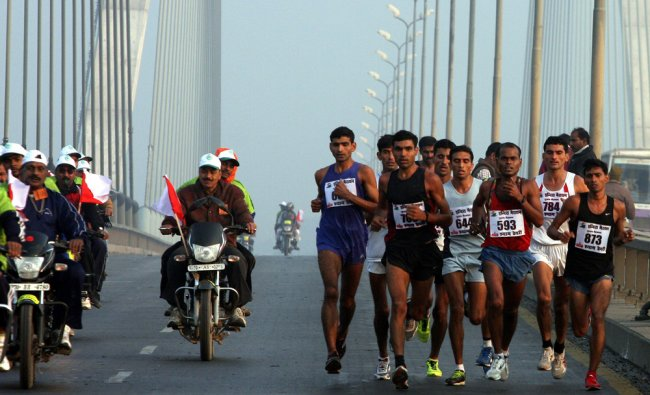 Indian participants take part in a marathon organized to mark the birth anniversary...