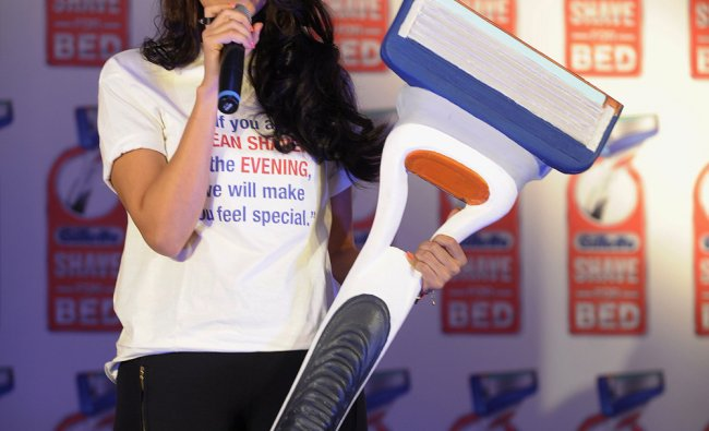 Indian Bollywood film actress Neha Dhupia poses during the Gillette \'shave or crave\' campaign...
