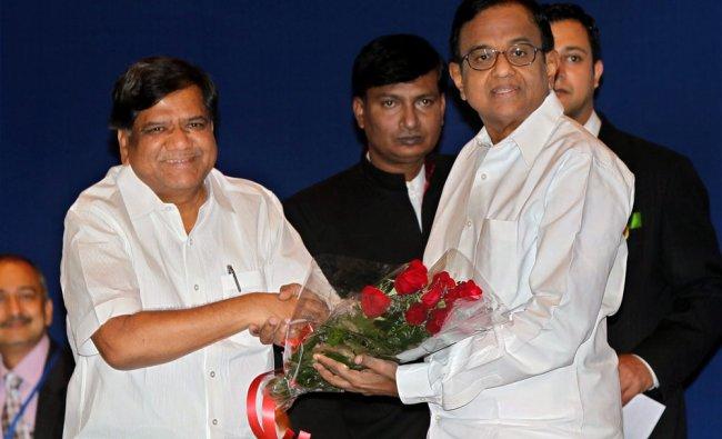 Union Finance Minister P Chidambaram being greeted by Karnataka Chief Minister Jagadish Shettar...