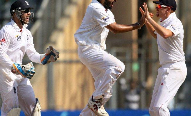 England bowler Monty Panesar celebrates with his teammates after dismissing India\'s Sachin...