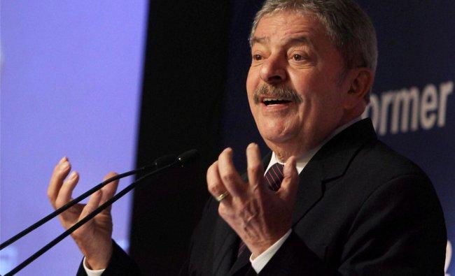 Former Brazilian President Luiz Inacio Lula da Silva speaks during a business meeting in New...