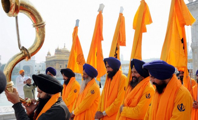 Punj Pyares lead a procession at Golden Temple in Amritsar on the eve of martyrdom day of Guru...