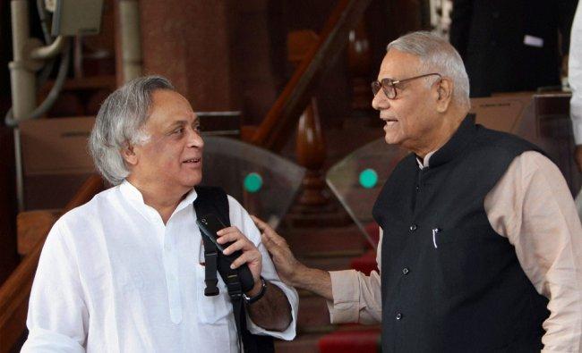 Union Minister for Rural Development Jairam Ramesh with senior BJP leader Yashwant Sinha at...