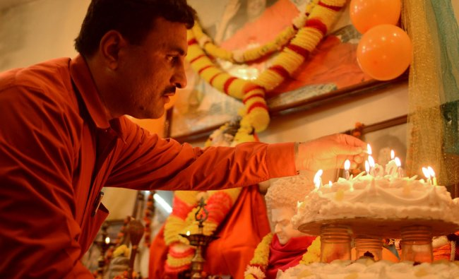 Hindus offer prayers as they celebrate the birth anniversary of Sathya Sai Baba in Amritsar...