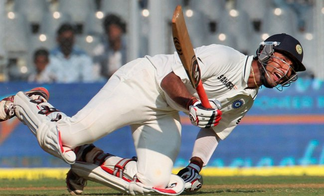 Cheteshwar Pujara slips while completing a run during the first day of second India-England Test...