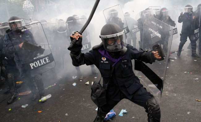 ear gas is thrown as police scuffle with anti-government protesters in Bangkok
