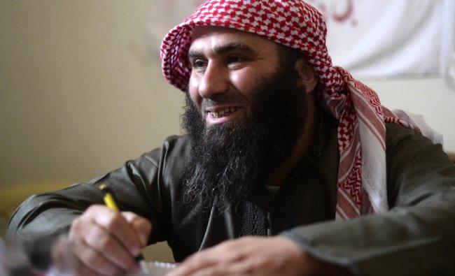 Sheikh Tawfik, head of the Noureddin Zinki battalion speaks to journalists
