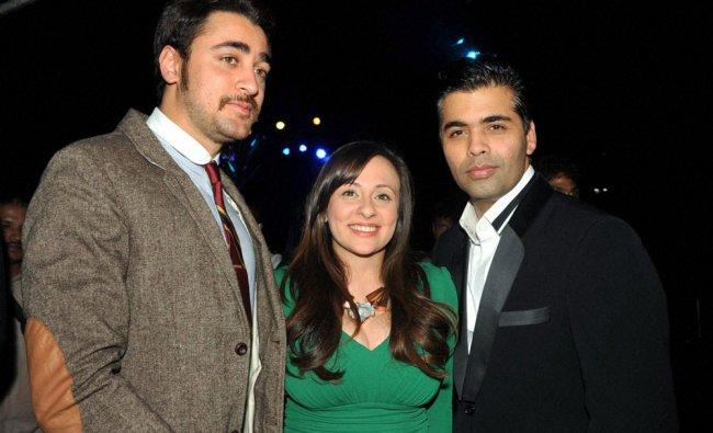 Director Karan Johar with actor Imran Khan and his wife Avantika at an event in Mumbai on Friday...