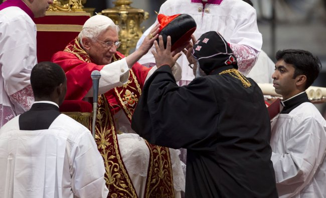 Newly elected Cardinal, Baselios Cleemis Thottunkal of India, right, is elevated to cardinal by...