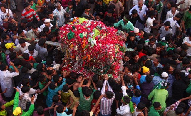 Indian Shiite Muslims take out a Tajiya or tableau during a religious procession on the tenth day...