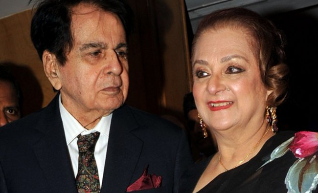 Indian Bollywood film actor Dilip Kumar (L) and his wife Saira Banu attend the Sun N Sand hotel....