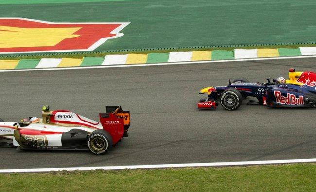 German Formula One driver Sebastian Vettel follows India\'s Narain Karthikeyan on November....