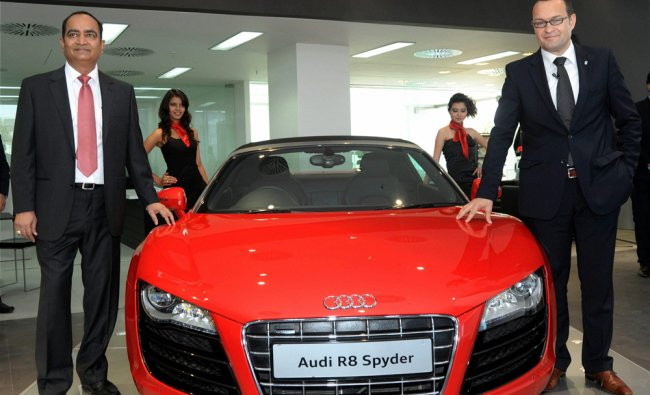 Audi India Chief Michael Perschke (right) and Audi Ahmedabad MD Samir Mistry pose next to an Audi...